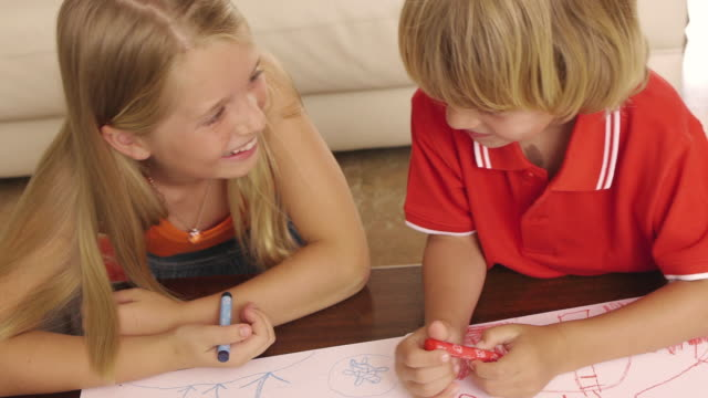 high angle shot of brother and sister coloring together/sotogrande,spain - crayon stock videos and b-roll footage
