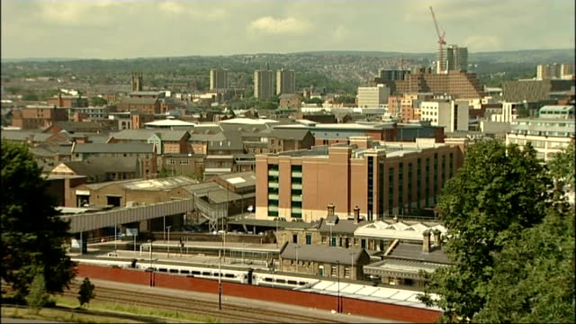 high angle shot of sheffield skyline with train along in f/g general view of city buildings low angle shot of house with 'to let' sign outside - sheffield stock videos & royalty-free footage