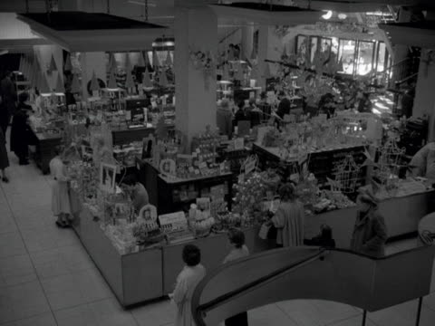 high angle shot of the cosmetics hall in a department store. 1957. - department store stock videos & royalty-free footage