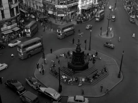 high angle shot of traffic moving around piccadilly circus. 1961. - angle stock videos & royalty-free footage
