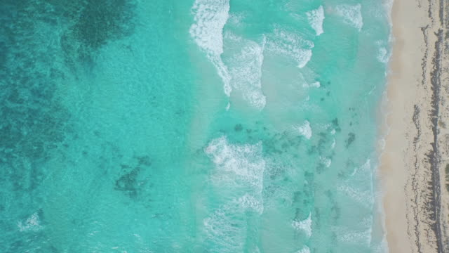 high angle shot of waves on beach - cozumel stock videos and b-roll footage