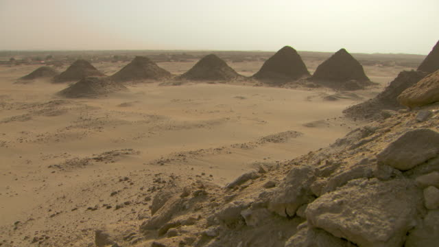 high angle shot over the ancient pyramids of nuri and the surrounding desert.  - pyramid stock videos and b-roll footage