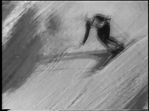 b/w 1962 high angle pan skier coming down slope in slalom competition / chamonix france / newsreel - einzelner mann über 30 stock-videos und b-roll-filmmaterial