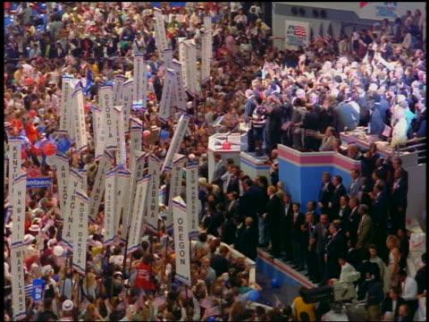 1988 high angle slight pan crowd holding signs at democratic national convention / atlanta georgia - 大統領選挙点の映像素材/bロール