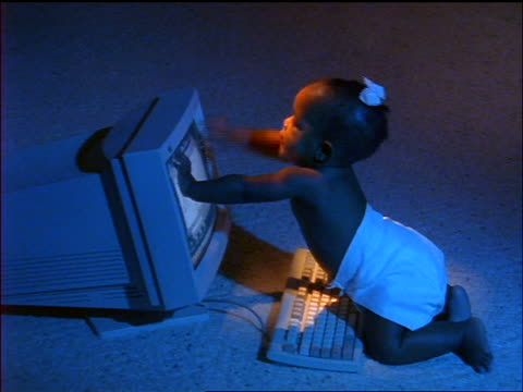 blue high angle slow motion black baby girl in diapers touching computer screen - 1998 stock videos & royalty-free footage