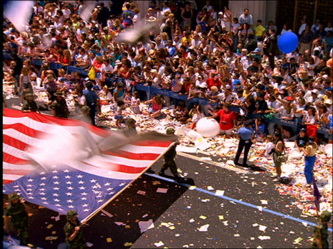high angle soldiers carrying american flag in ticker tape parade / operation welcome home / nyc - ticker tape stock videos and b-roll footage