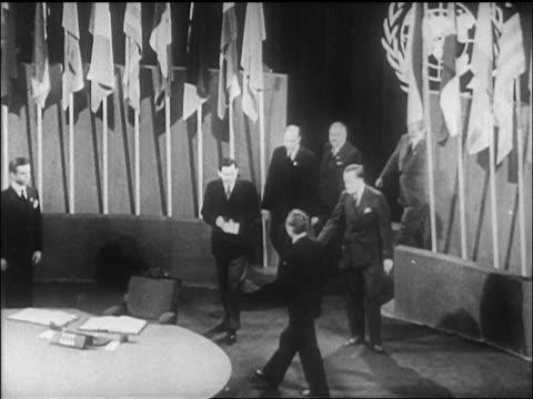 vídeos de stock, filmes e b-roll de b/w 1946 high angle soviet delegate entering room to sign un charter treaty / sf / newsreel - 1946