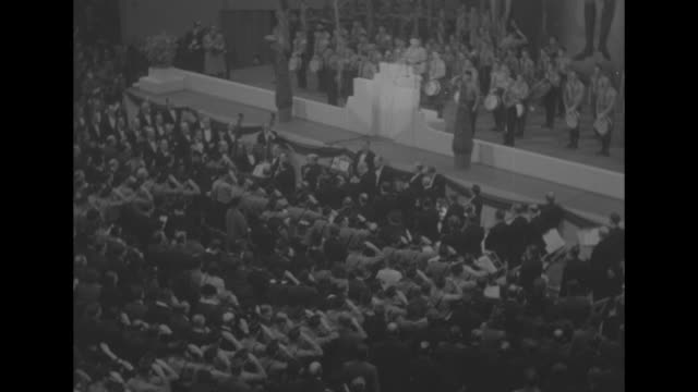 high angle ws stage with speaker at the germanamerican bund rally in madison square garden sot speaker calls for audience attention / vs pan members... - pledge of allegiance stock videos & royalty-free footage