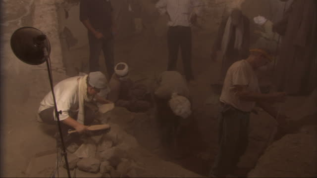high angle, static - technicians work at an archaeological excavation site in egypt - finding stock videos and b-roll footage