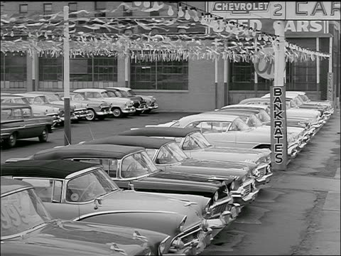 b/w 1958 high angle station wagon parks in used car lot - car showroom stock videos & royalty-free footage