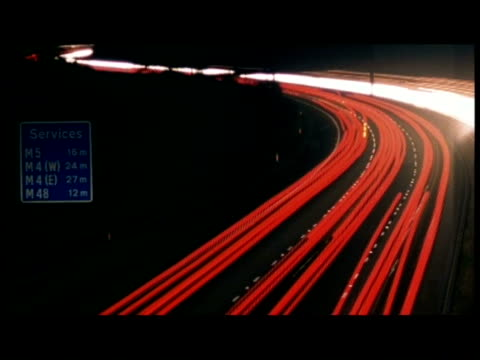 T/L High angle, streaky night travelling away from camera along busy motorway at night (Driving on left hand side of road)