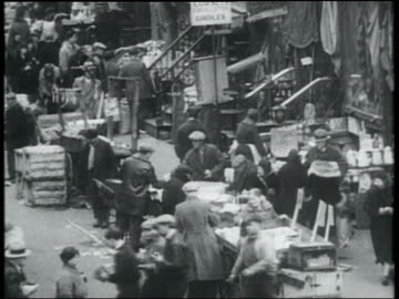 b/w 1932 high angle street vendors with pushcarts + customers in lower east side, nyc - great depression stock videos & royalty-free footage