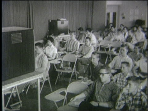 b/w 1950 high angle students sitting at desks watching television in classroom - teenage girl watching tv stock videos & royalty-free footage