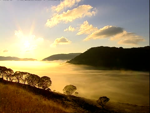 WA High angle, Sunrise over mist-filled valley