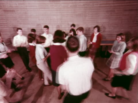 1965 high angle teen couples dancing in gym at ymca youth dance / indianapolis, indiana / educational - early rock & roll stock videos and b-roll footage