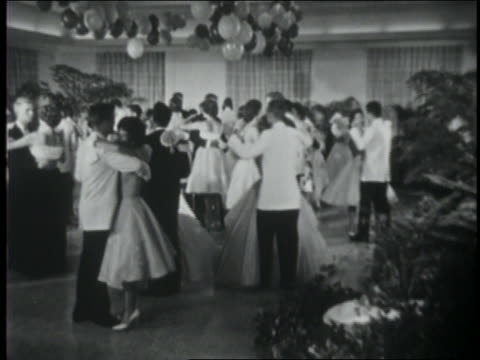 b/w 1961 high angle teen couples dancing on dance floor at prom / balloons above / coca-cola educational - 1961 stock-videos und b-roll-filmmaterial