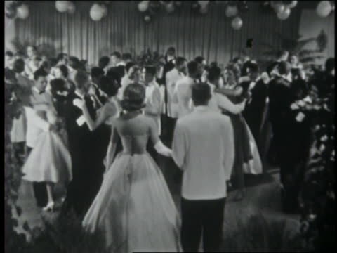 b/w 1961 high angle teen couples dancing on dance floor at prom / coca-cola educational - 1961 stock-videos und b-roll-filmmaterial