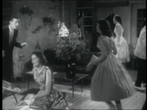 b/w 1957 high angle pan teenage couples dancing energetically at party + drinking at bar - klassischer rock and roll stock-videos und b-roll-filmmaterial