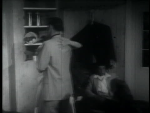 b/w 1957 high angle pan teenage couples slow dancing at party / lights dim as one couple walks outside - boyfriend stock videos & royalty-free footage