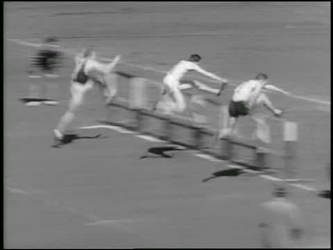 b/w 1934 high angle pan three men jumping hurdles in relay race / philadelphia / newsreel - relay stock videos and b-roll footage