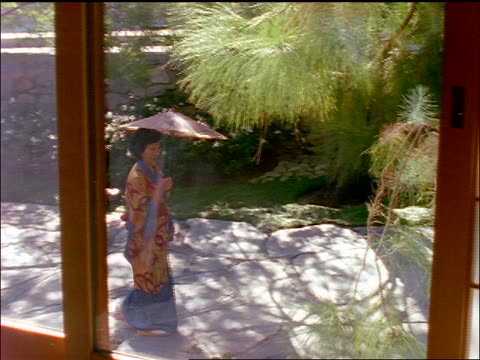 high angle through window of asian woman in kimono with parasol walking in garden - parasol stock videos & royalty-free footage