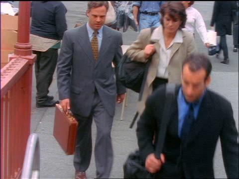 vídeos de stock, filmes e b-roll de high angle tilt down businesspeople entering subway station / new york city - 1990