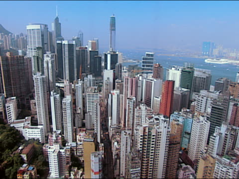 2002 high angle tilt down hong kong cityscape from descending skyscraper elevator/ tilt down zoom in building/ hong kong - bank of china tower hong kong bildbanksvideor och videomaterial från bakom kulisserna