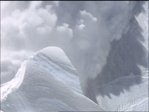high angle tilt down huge avalanche on mountainside / Mt Everest
