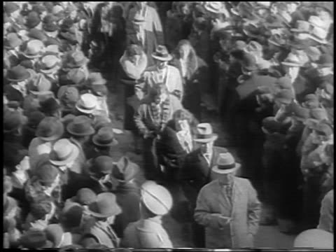 high angle tilt down men + women of jury passing crowd at lindbergh kidnapping trial / flemington, nj - 1935 stock videos & royalty-free footage