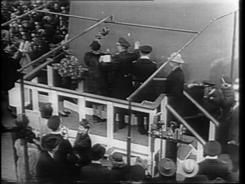 high angle tilt shot of the stern of the uss missouri as it sits near the dock / high angle shot of the crowd around the ship / shot of senator harry... - uss missouri stock videos and b-roll footage