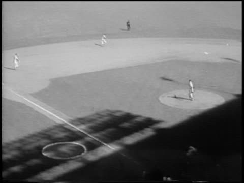 b/w 1956 high angle tilt up don larsen pitching a 'perfect game' with gil hodges batting mickey mantle catching ball in outfield / game 5 of the... - baseballmannschaft stock-videos und b-roll-filmmaterial