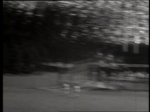 b/w high angle tilt up of mickey mantle hitting home run / milwaukee / 22nd annual all star game / sound - 1955 stock videos & royalty-free footage