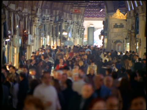high angle tilt up tilt down crowd walking in covered market / Grand Bazaar, Istanbul, Turkey