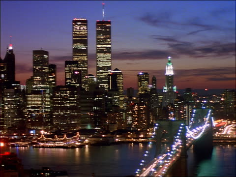 high angle time lapse downtown manhattan skyline + brooklyn bridge / sunset to night - 1997 stock videos & royalty-free footage