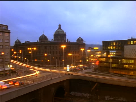 high angle time lapse dusk to night traffic at intersection in front of National Museum / Prague, Czech Republic