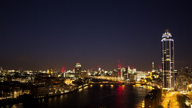 High angle, time lapse of the River Thames and Central London at night