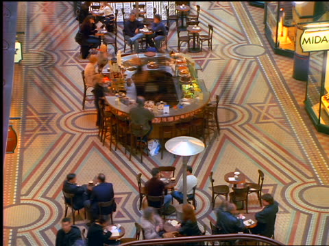 high angle time lapse people eating at + walking by cafe in lobby of queen victoria building / sydney, australia - food court stock videos and b-roll footage