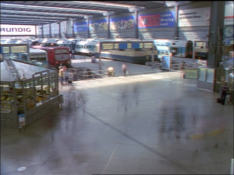 high angle time lapse people in main munich train station / germany - 1998 stock-videos und b-roll-filmmaterial