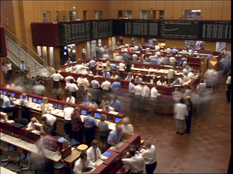 high angle time lapse people on floor of frankfurt stock exchange / germany - anno 1997 video stock e b–roll