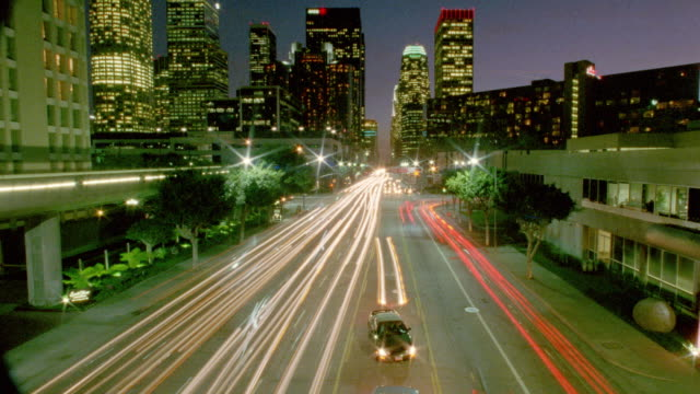 high angle time lapse traffic driving on los angeles streets from day to night - day to night time lapse stock videos & royalty-free footage