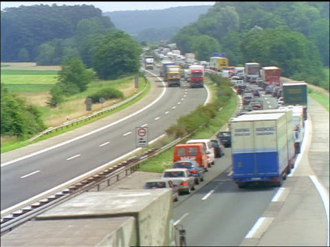 high angle time lapse traffic jam on autobahn near munich / germany - londonalight stock videos and b-roll footage