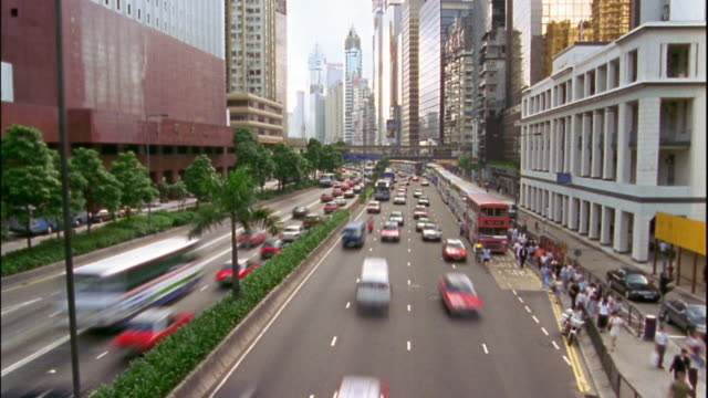 vídeos y material grabado en eventos de stock de high angle time lapse traffic on city street / hong kong - 1996