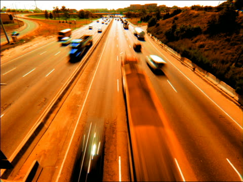 vidéos et rushes de high angle time lapse traffic on highway / orange filter - 1990 1999