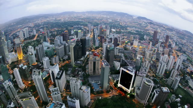 high angle time lapse wide shot golden triangle cityscape at night/ kuala lupur - wide angle stock videos & royalty-free footage