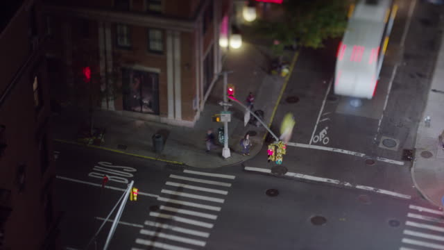 high angle time lapse wide shot of traffic in intersection / new york, new york, united states - crosswalk sign stock videos & royalty-free footage