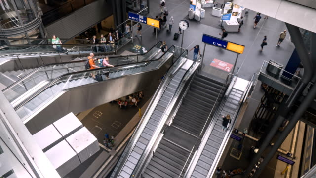 high angle timelapse: crowd of traveller and passenger on escalator - escalator stock videos & royalty-free footage