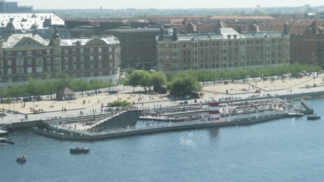 high angle tl view of havnebadet islands brygge or copenhagen harbour baths, crowds enjoying to swimming,  denmark - copenhagen stock videos & royalty-free footage