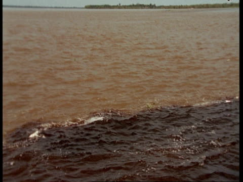 stockvideo's en b-roll-footage met ms high angle tracking over choppy water as the amazon and rio negro meet, south america - color negro