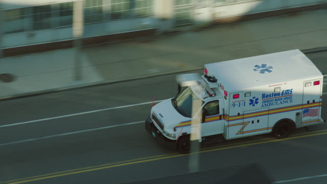 vídeos de stock, filmes e b-roll de high angle tracking shot of ambulance - ambulância