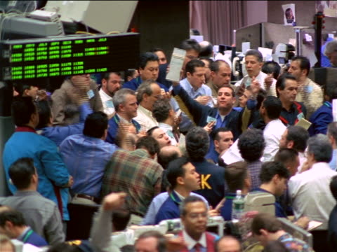 high angle traders shouting + making hand signals on exchange floor / coffee, sugar + cocoa exchange, nyc - bull market stock videos & royalty-free footage